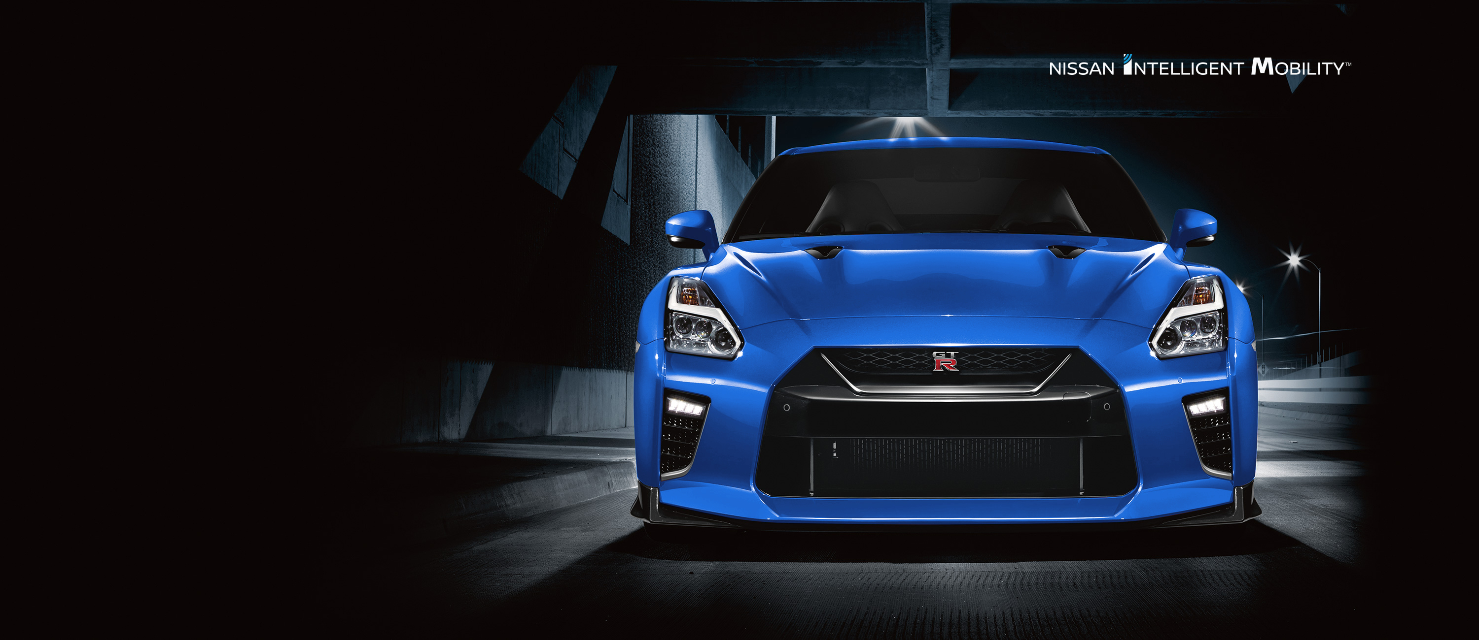 Blue Nissan GT-R Sports Car Front in warehouse