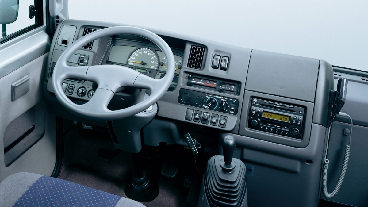 grey Nissan civilian dashboard