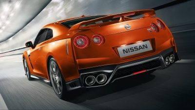 orange gt-r rear exterior