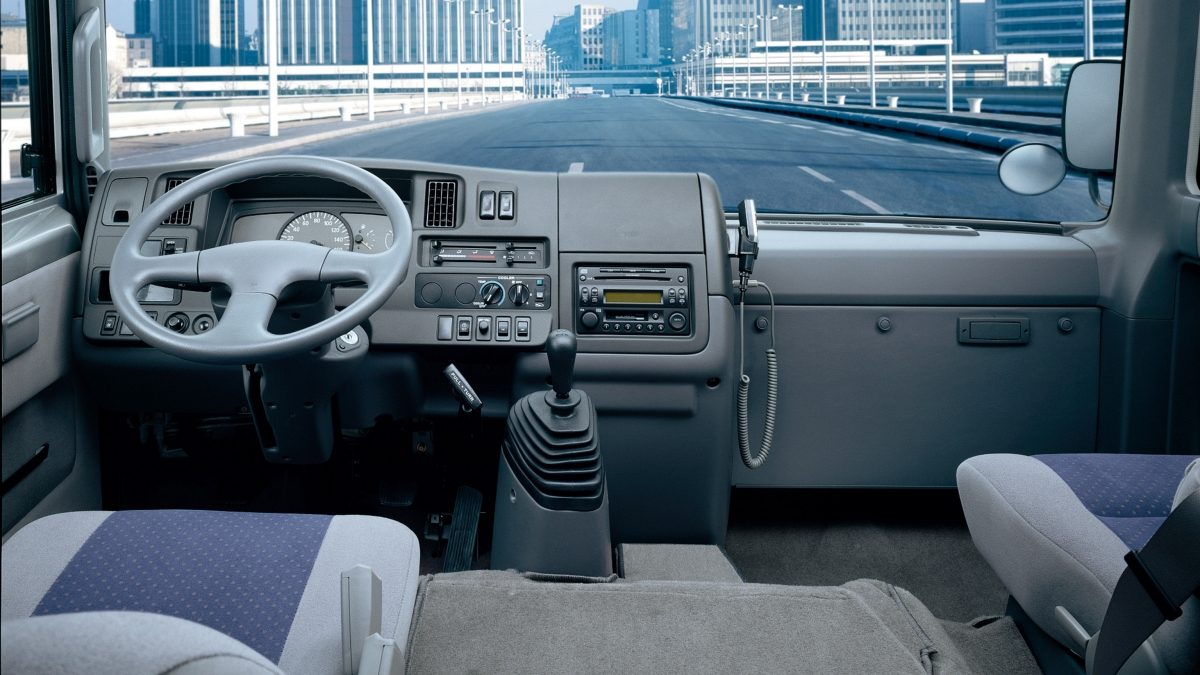 The dashboard, control panel and steering wheel of Nissan civilian