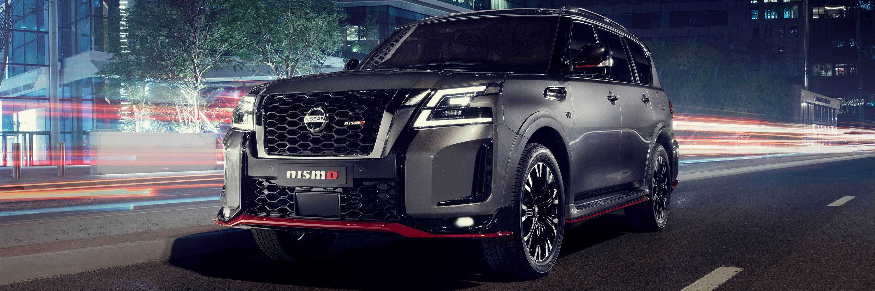 Nissan PATROL NISMO on a city road at night