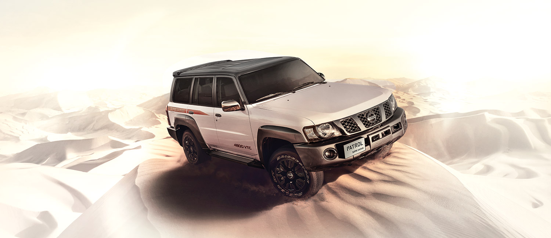 White Nissan Patrol safari car in the desert