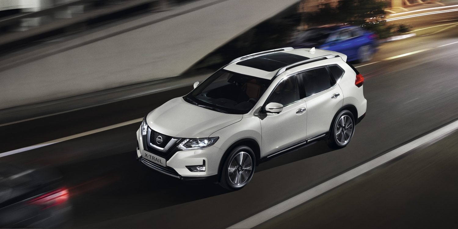 white Nissan X-TRAIL on the road